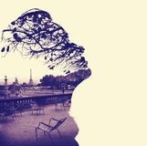 Silhouette of a female head profile, framing Paris Eiffel Tower Stock Photography