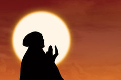 Silhouette of female muslim pray at sunset. Silhouette of female muslim praying at sunset Royalty Free Stock Photos