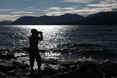 Silhouette of a Female Photographer Near Mountain Stock Images