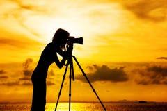 Silhouette female photographer Stock Image
