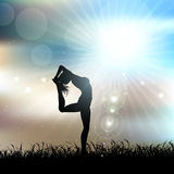 Silhouette of a female in a yoga pose in sunny landscape Royalty Free Stock Photography