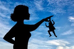 Silhouette feminist holding a small man. stock photos