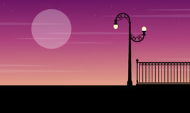 Silhouette of fence with street lamp scenery. Vector art royalty free illustration