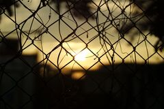 Silhouette Fence during Sunset Stock Photography