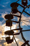 Silhouette of ferris wheel in amusement park at dusk. Silhouettes of ferris wheel cabins in amusement park at dusk Royalty Free Stock Photos