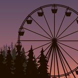 Silhouette of Ferris wheel. In spuce park on the sunset Stock Photography