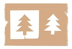 Silhouette of fir cut out from paper on cardboard. Silhouette of fir tree cut out from paper on cardboard Stock Images