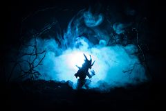Silhouette of fire breathing dragon with big wings on a dark blue cold background Royalty Free Stock Image