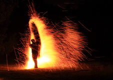 Silhouette in fire. Silhouette of a girl in fire sparks on fireshow Royalty Free Stock Photos