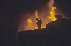 Silhouette of fireman in front of blaze, Beverly Hills, California Stock Images