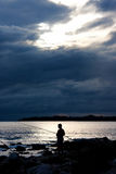 Silhouette of fisherman Royalty Free Stock Image