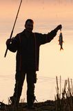 Silhouette of Fisherman Royalty Free Stock Photos