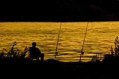 Silhouette Of Fisherman Royalty Free Stock Photography