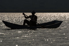Fisherman in the evening sun in Africa Stock Photography