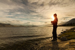 Silhouette of the fisherman Stock Images