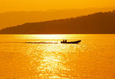 Silhouette of fisherman on a boat Royalty Free Stock Photography