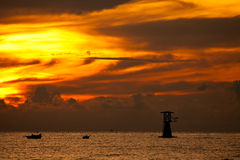 Silhouette of fisherman boat on sunrise Royalty Free Stock Images