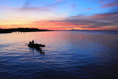 Silhouette of fisherman boat Royalty Free Stock Image