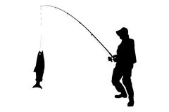 A silhouette of a fisherman with a fish Stock Photos