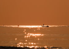 Silhouette fisherman fishing golden sea beautiful shine. Natural in morning Royalty Free Stock Photography