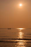 Silhouette fisherman fishing golden sea beautiful shine. Natural in morning Stock Images