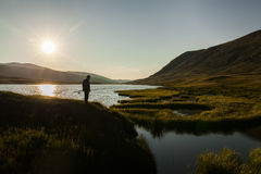Silhouette of a fisherman with a fishing rod Royalty Free Stock Images