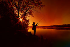 Silhouette of a fisherman stock photography