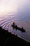 Silhouette of fisherman Stock Images