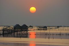 Silhouette of fisherman house. In thailand on sunset Stock Photos