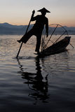 Silhouette of a fisherman on Inle Lake Royalty Free Stock Image