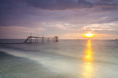 Silhouette of fisherman jetty during sunrise Stock Photo