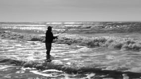 Silhouette of fisherman at the ocean. royalty free stock photos