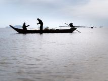 Silhouette of fisherman Stock Photography