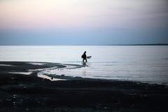 Silhouette fisherman Stock Image