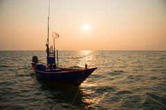 Silhouette fisherman`s boat. Stock Photos