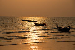 Silhouette fisherman`s boats. Stock Photography