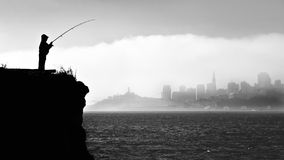 Silhouette of a fisherman in San Francisco Royalty Free Stock Photos