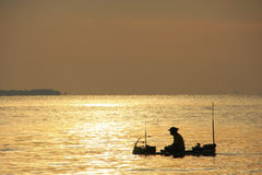 Silhouette of fisherman at sunrise, Gulf of Thailand, Cambodia Stock Images