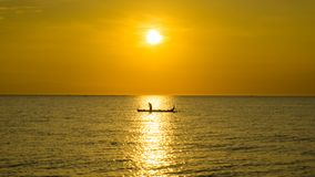 A silhouette of fisherman with sunset backgrouund. This image show a silhouette of fisherman with sunset background. this image have a very good composition and stock image