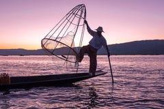 Silhouette of fisherman at sunset Inle Lake Burma Myanmar Royalty Free Stock Photos