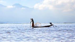 Silhouette of fisherman at sunset Inle Lake Burma Myanmar Royalty Free Stock Photo