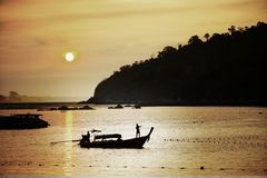 Silhouette of fisherman with sunset or sunrise. Background Royalty Free Stock Photography