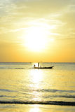Silhouette fisherman are taking fishing boat Stock Photography
