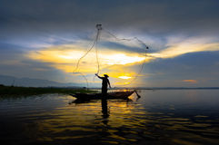 Silhouette fisherman Stock Photography