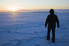 Silhouette of a fisherman walking on the lake Stock Photography