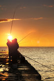 Silhouette of fishermen Royalty Free Stock Photography