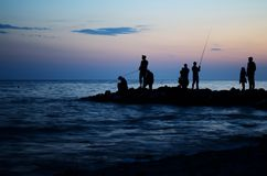 Silhouette of fishermen Royalty Free Stock Images