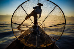 Silhouette fishermen in Inle Lake at sunrise, Myanmar Royalty Free Stock Photography