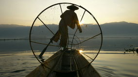 Silhouette fishermen in Inle Lake at sunrise, Myanmar stock video footage
