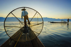 Silhouette fishermen in Inle Lake at sunrise, Shan State, Myanma Royalty Free Stock Photos